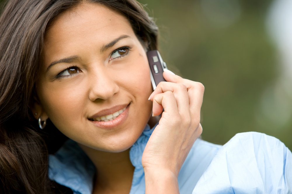 casual woman talking on a mobile phone outdoors